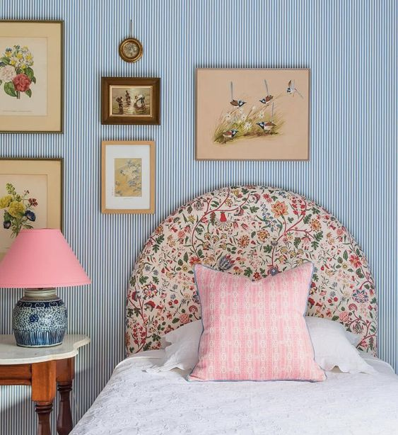 blue ticking stripe wallpaper with patterned headboard girls room