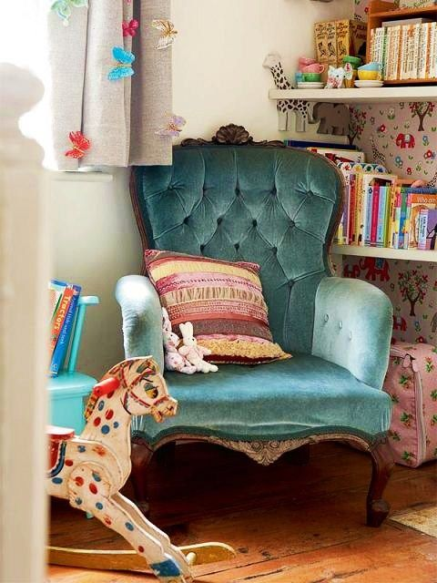 blue tufted chair in girls bedroom reading nook