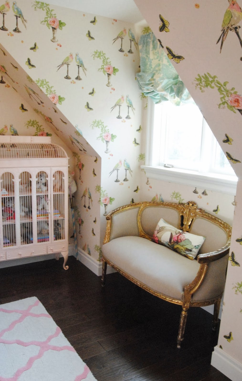 girls room gilt settee in window alcove with bird cage
