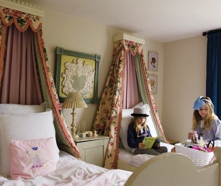 girls room with pair of twin beds with mini canopies