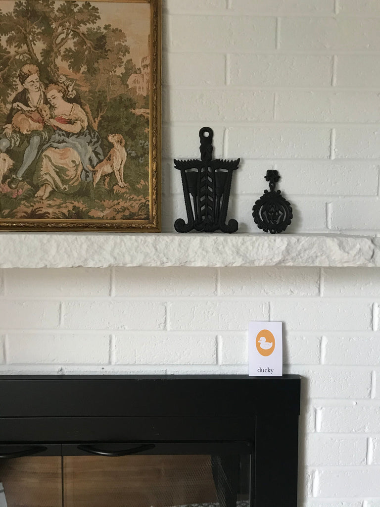 rubber ducky cameo flashcard hiding on fireplace