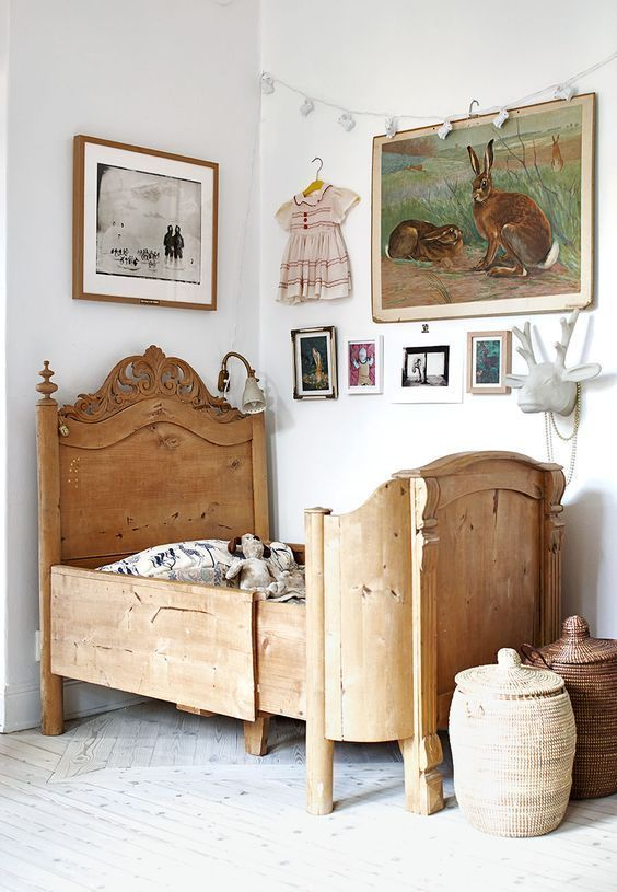 mixed artwork in traditional girls bedroom with antique wooden bed