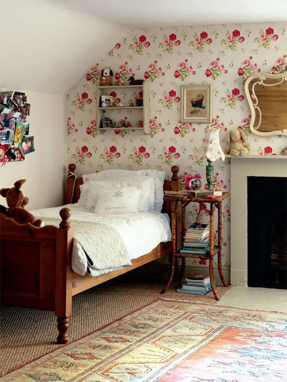 pink floral wallpaper accent wall in girls room