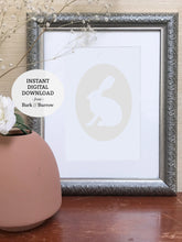 Load image into Gallery viewer, ivory rabbit cameo art print shown in silver frame with terra-cotta vase