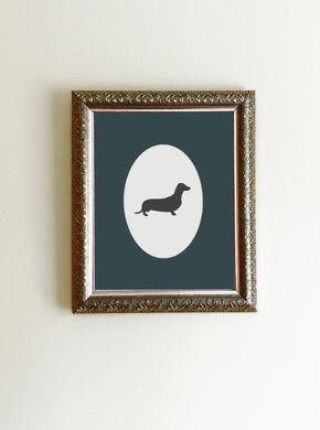 black and white dachshund silhouette framed with blue photo mat