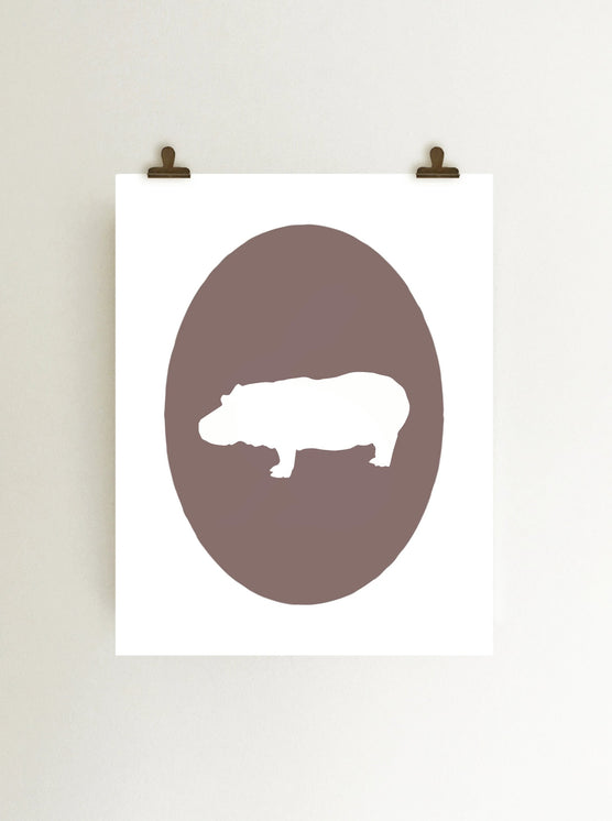 Hippopotamus cameo giclee art print in purple on white paper shown hanging with clips on wall