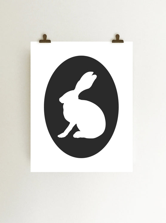 Black rabbit cameo giclee art print on white fine art paper shown hanging from clips on wall
