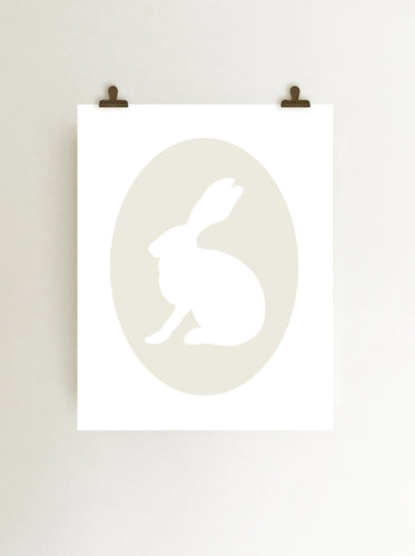 Ivory rabbit cameo giclee art print on fine art paper shown hanging on wall from clips
