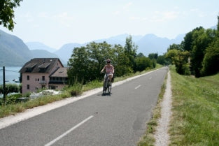 Cycling by Lake Annecy