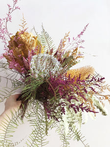 A large dried flower bouquet made with King Flower, Banksia, Sea Star Fern. Bright and Colorful dried flowers.