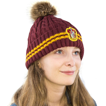 Official Gryffindor Pompom Beanie at the best quality and price at House Of Spells- Harry Potter Themed Shop In London. Get Your Gryffindor Pompom Beanie now with 15% discount using code FANDOM at Checkout. www.houseofspells.co.uk.