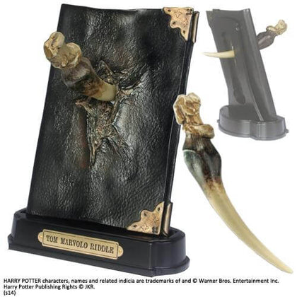 Official Basilisk Fang And Tom Riddle Diary Sculpture at the best quality and price at House Of Spells- Harry Potter Themed Shop In London. Get Your Basilisk Fang And Tom Riddle Diary Sculpture now with 15% discount using code FANDOM at Checkout. www.houseofspells.co.uk.