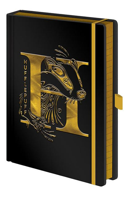 Official Harry Potter Hufflepuff Foil Premium A5 Notebook at the best quality and price at House Of Spells- Harry Potter Themed Shop In London. Get Your Harry Potter Hufflepuff Foil Premium A5 Notebook now with 15% discount using code FANDOM at Checkout. www.houseofspells.co.uk.