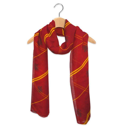 Official Gryffindor Lightweight Scarf at the best quality and price at House Of Spells- Harry Potter Themed Shop In London. Get Your Gryffindor Lightweight Scarf now with 15% discount using code FANDOM at Checkout. www.houseofspells.co.uk.