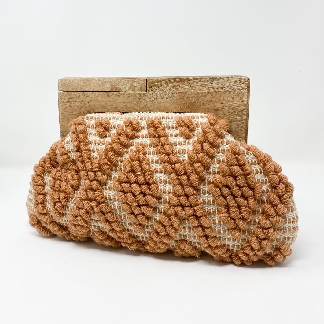 Sol woven clutch