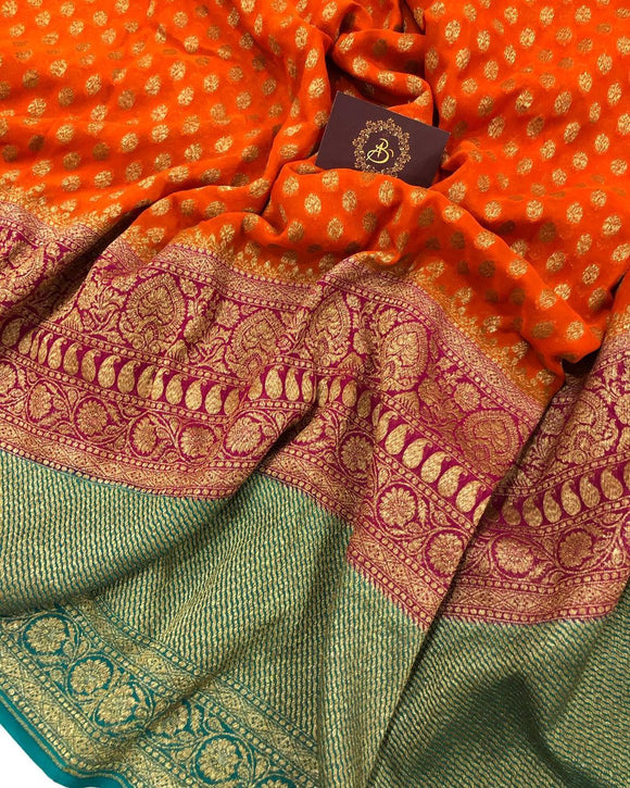 ORANGE BANARASI HANDLOOM PURE KHADDI GEORGETTE SILK SAREE WITH 17 INCHES BROAD BORDER