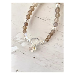 Silver charm and beaded bracelet