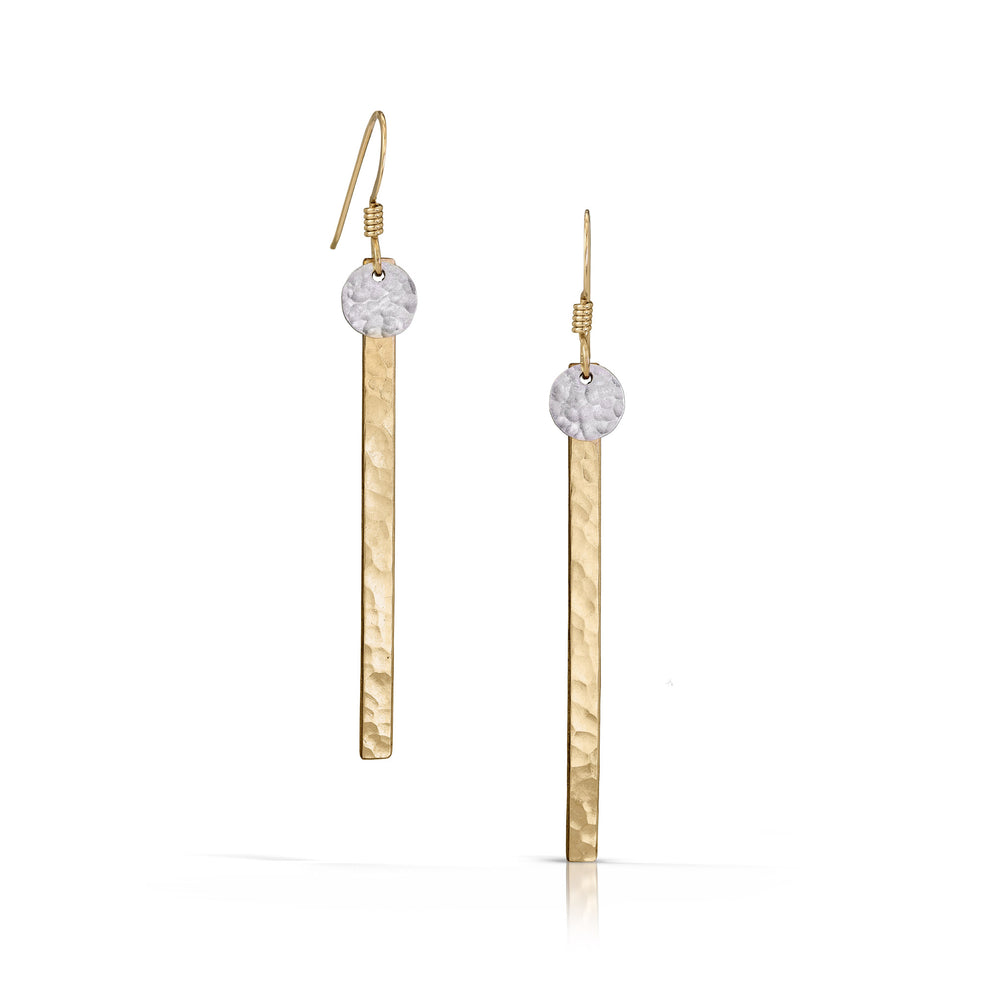 Small textured silver disc on gold skinny bar earrings.