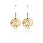 Textured gold flat round earrings.
