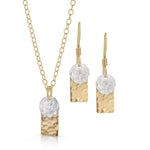 Textured gold rectangle and silver disc jewelry set.
