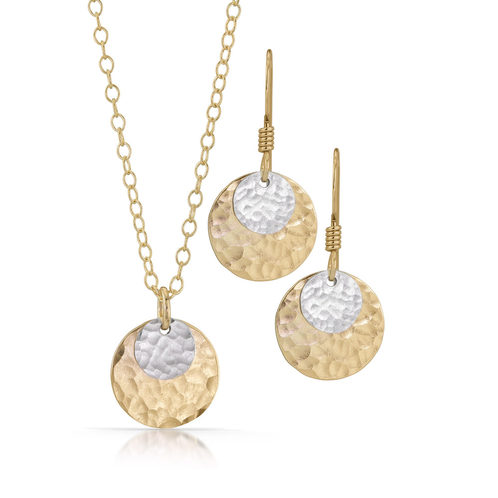 Small silver disc on large gold disc jewelry set.
