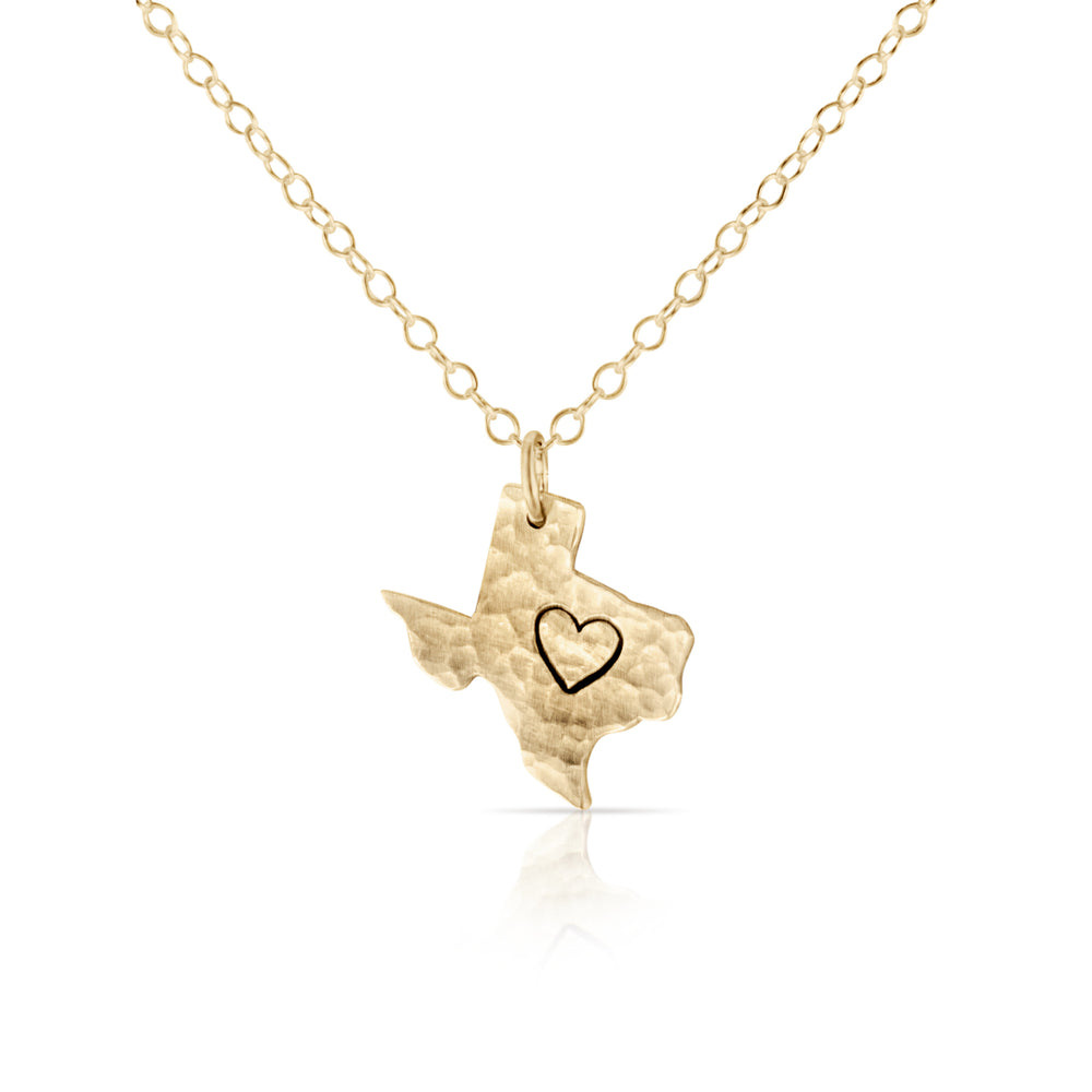 Gold texas heart charm necklace.