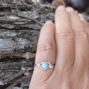 Larimar wire wrap sterling silver ring.