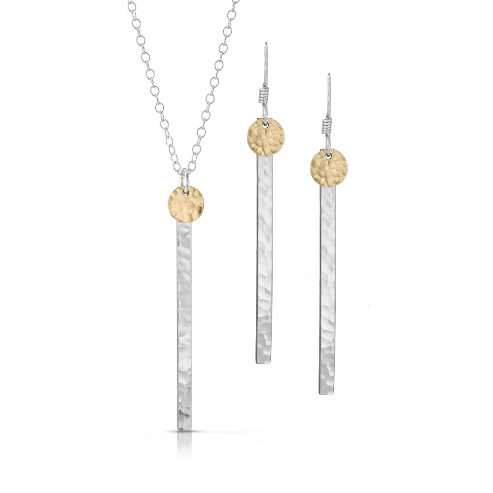 Small textured gold disc on skinny silver bar jewelry set.