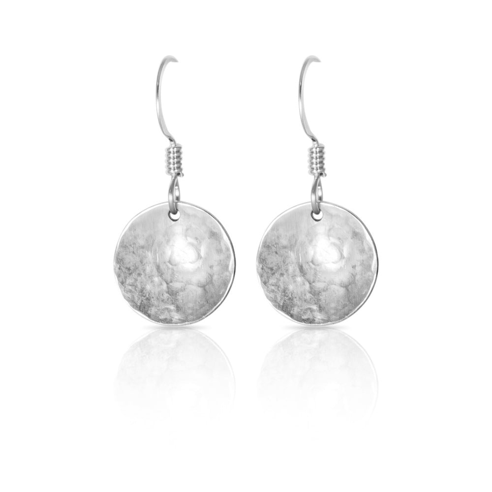 Silver concave disc earrings.