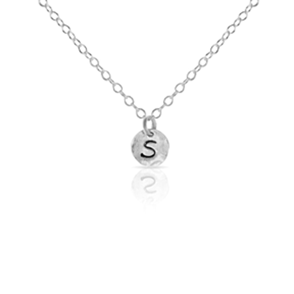Mini silver initial necklace.