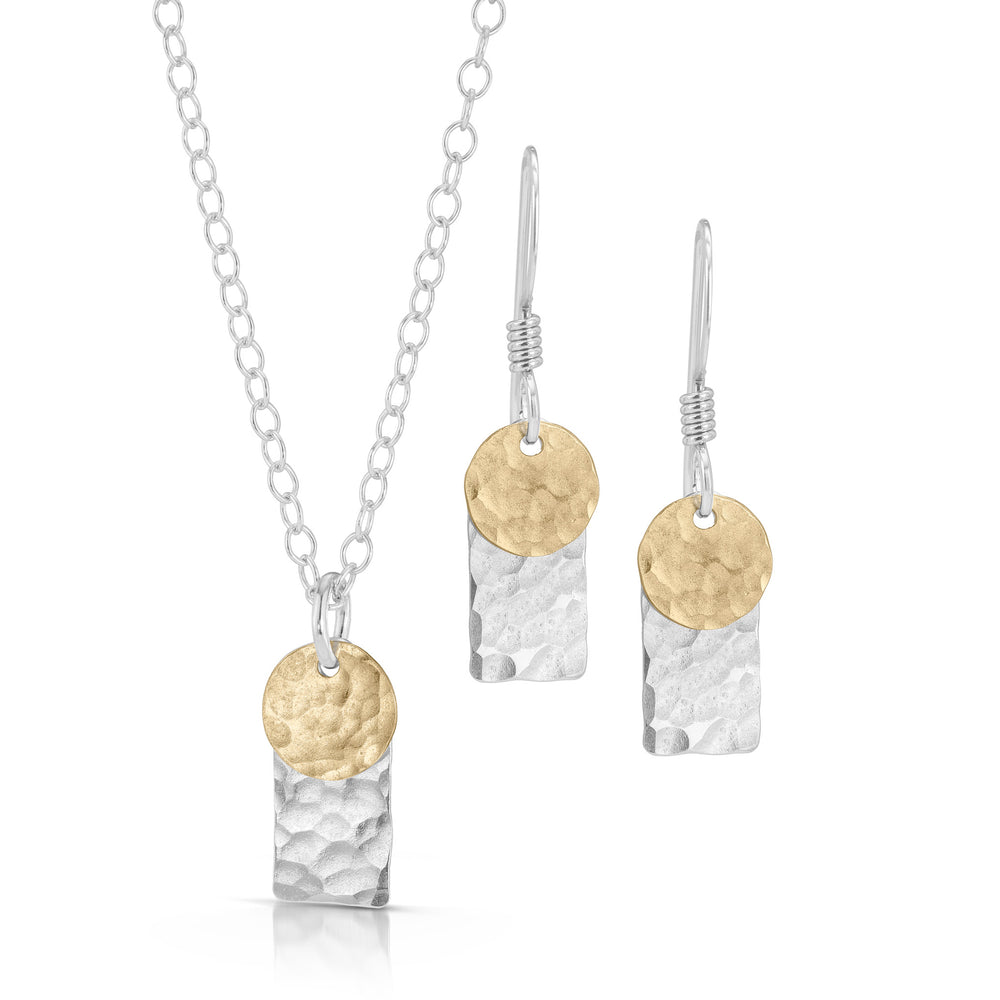 Silver rectangle and gold disc jewelry set.