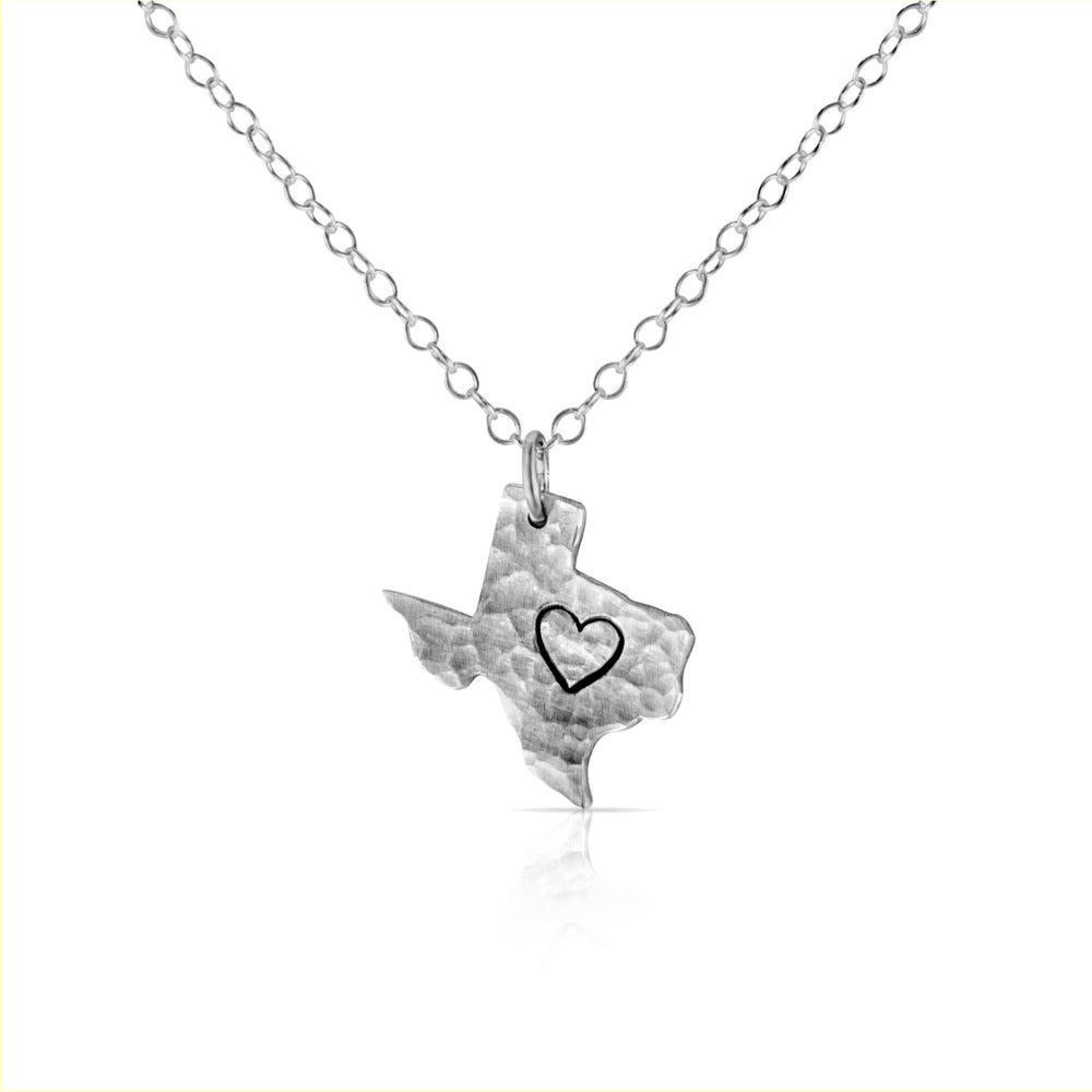 Silver texas heart necklace.