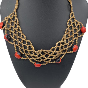 Braided seed necklace with accent red seeds