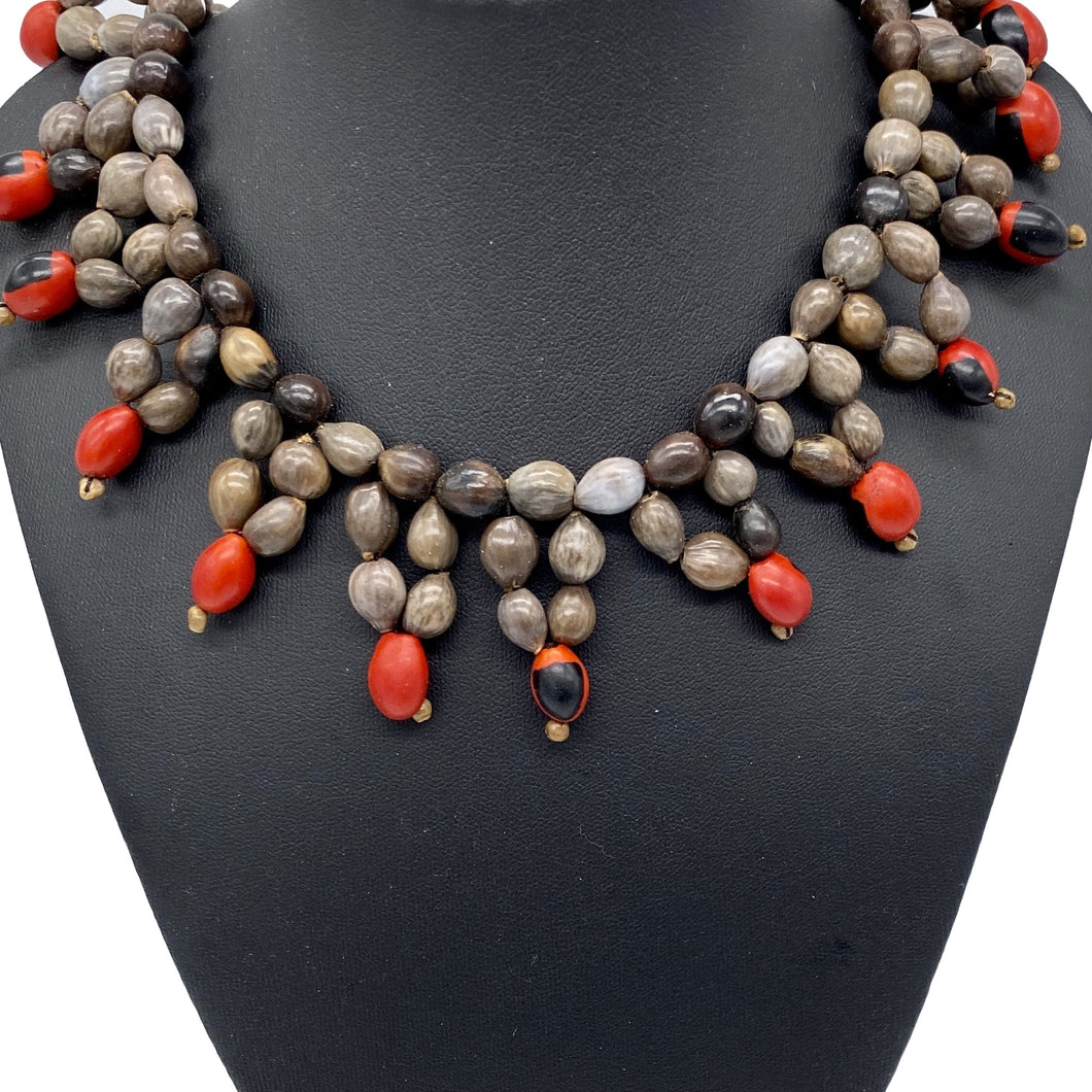 Star shaped red and grey seed necklace