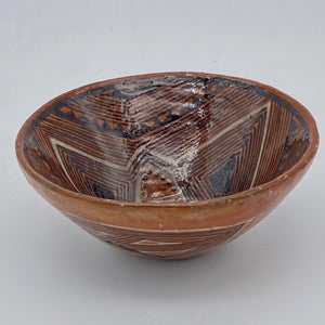 Converging lines pottery bowl