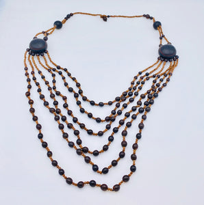 Layered black seed long necklace