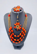 Load image into Gallery viewer, Stunning multi strand red seed necklace with matching earrings