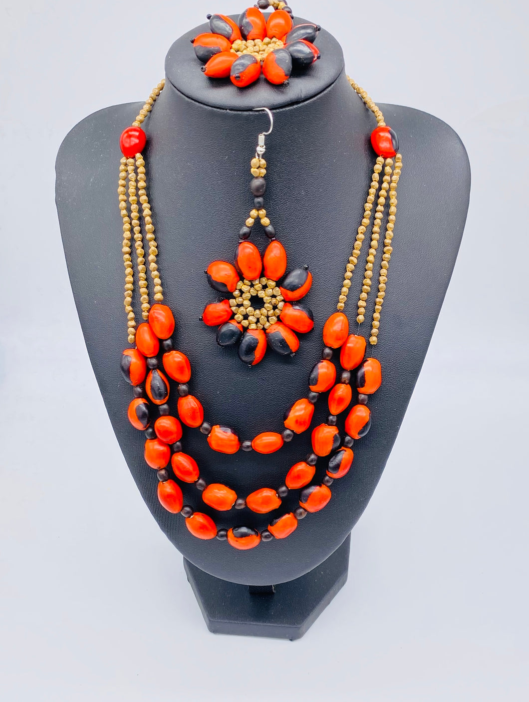 Stunning multi strand red seed necklace with matching earrings