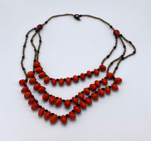 Three strand red seed necklace