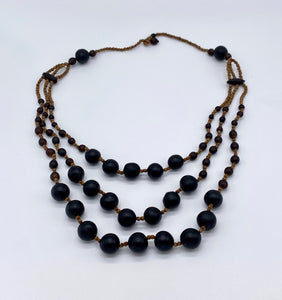 Triple layered black seed necklace