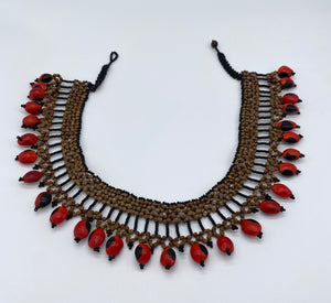 Thick band necklace edged with fiery seeds