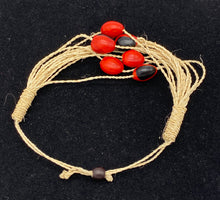 Load image into Gallery viewer, Woven strand bracelet with red and black seeds