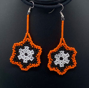 Perfect for halloween or your favorite sports fan. Simple orange, black and white center