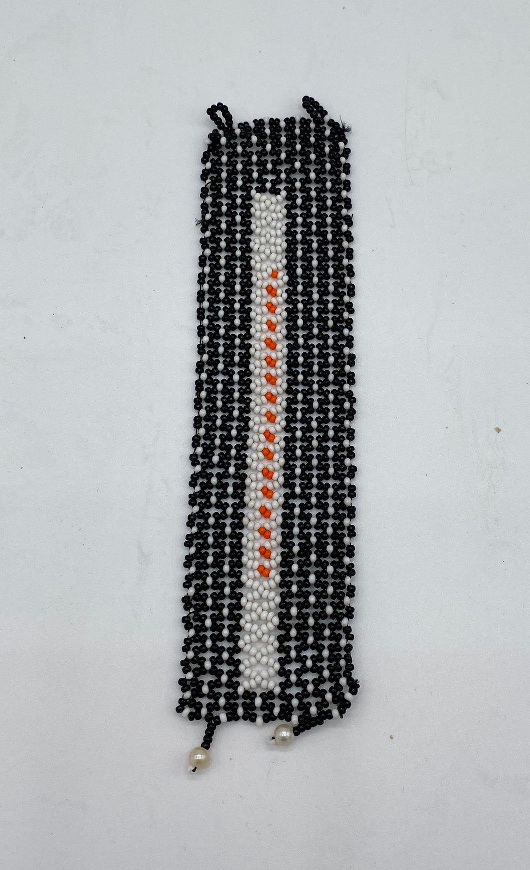 White rectangle with orange beads with surrounding color