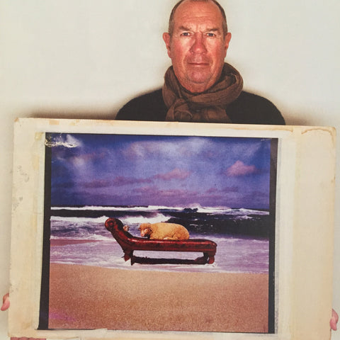 Aubrey Powell with the original artwork for 10cc Look Here album cover