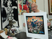 Alan Aldridge with his print of Elton John's Captain Fantastic album cover
