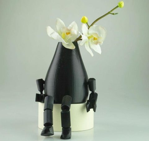 Flower vase with articulated limbs