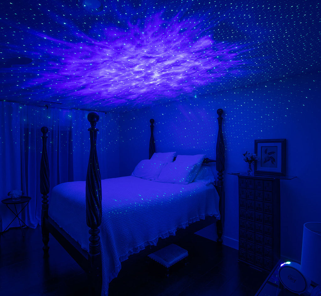 galaxy light over four-poster bed