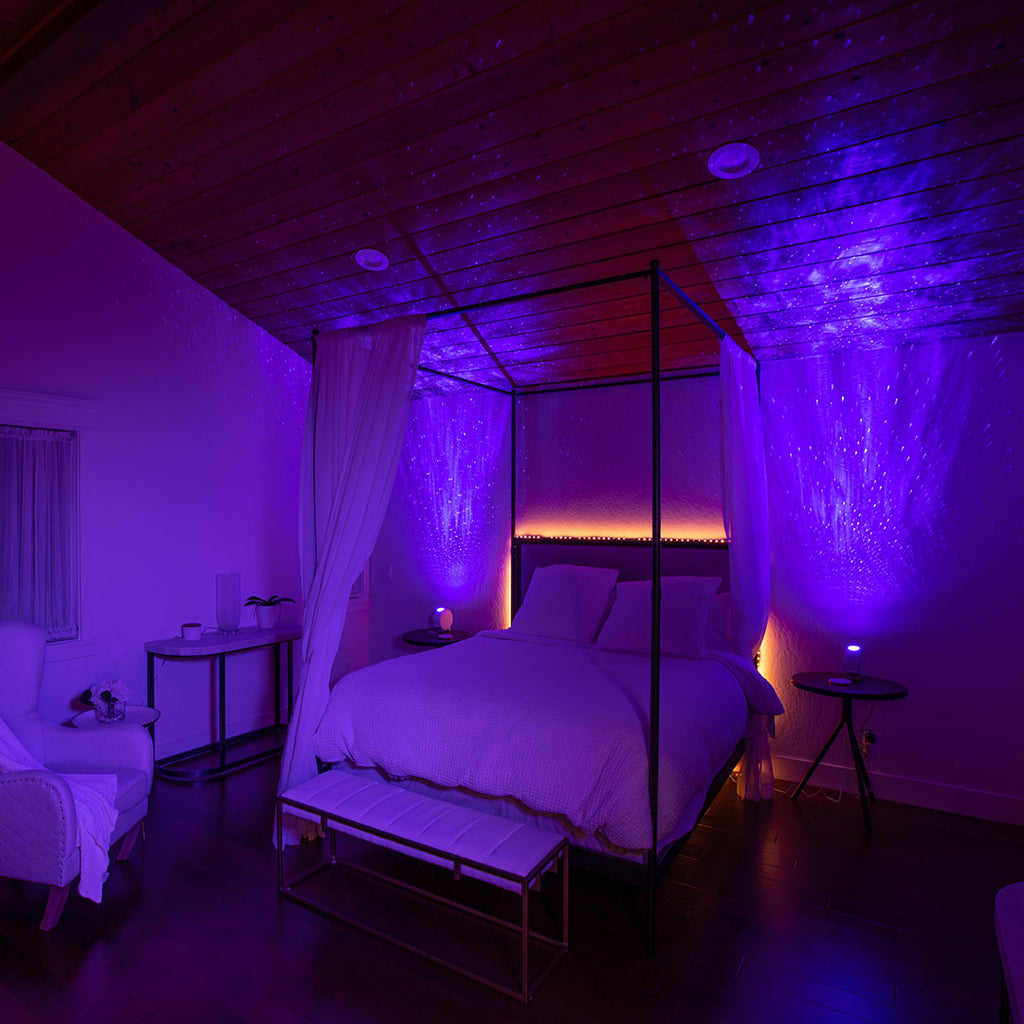 canopy bed with orange led backlighting and two galaxy lights