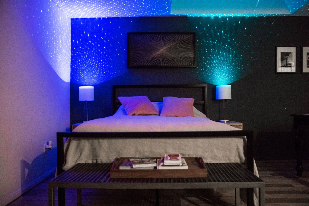 blue and green laser lightbulbs in bedroom